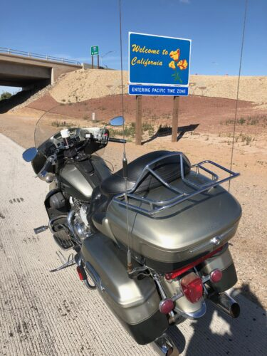 Motorcycle In Front Of California Sign